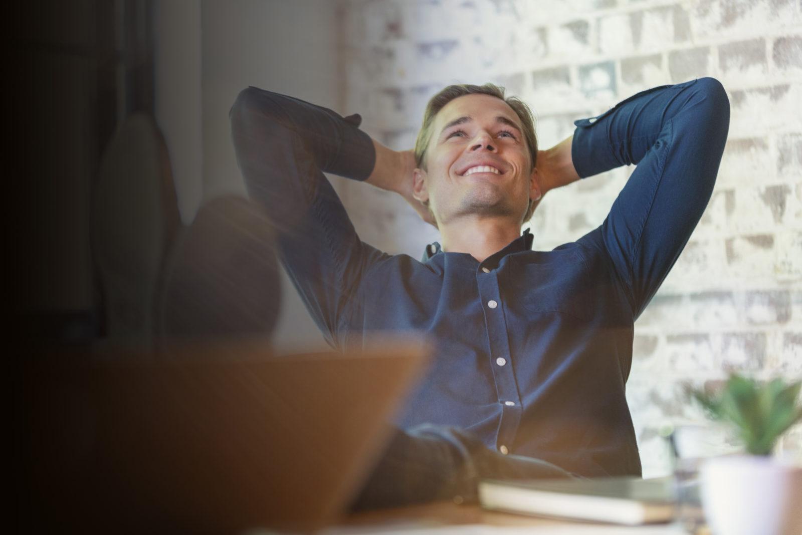 Young businessman enjoying his success